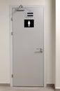 Grey toilet doors for male genders Royalty Free Stock Photo