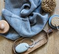 Grey towel with body brush, rustic footcare accessory, top view Royalty Free Stock Photo