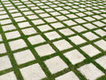 Grid of grass and paving stones Royalty Free Stock Photo