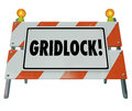 Gridlock road barrier barricade warning traffic sign as a construction or to illustrate a stoppage obstruction challenge dead end Stock Photos