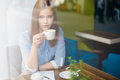 Grievous woman in the coffee shop Royalty Free Stock Photo
