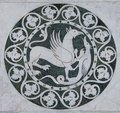 Griffin mythical animal in a decorative circle on the Chiesa dei Santi Giovanni e Reparata Royalty Free Stock Photo