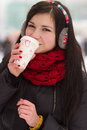 Gril drinking coffee in iwinter Royalty Free Stock Images