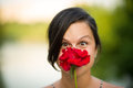Gril with red rose young girl playing a Royalty Free Stock Images