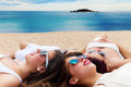Grilfriends relaxing together on carribean beach portrait of cute teen girlfriends laying with heads Stock Image