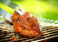 Grill beef steak barbeque flames grilling a on the bbq Stock Image
