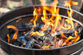 A grill with charcoal and flames Royalty Free Stock Photo