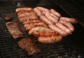 Grill cooking with chorizo sausages and skirt steak Royalty Free Stock Photo