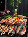 Grill food grilling on the bbq on a summer day boerewors skewers shashliks sausages herbs and vegetables Royalty Free Stock Photo