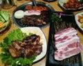 Grill pork slice on the hot BBQ pan, family dinner time, Korea food, yakiniku, Korea town Royalty Free Stock Photo
