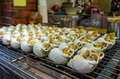Grill snails in jiufen taiwan Royalty Free Stock Image