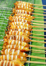 Grill squid in row on banana leaf thai street food Royalty Free Stock Photos