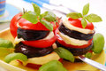 Grilled aubergine with tomato and mozzarella Stock Photo