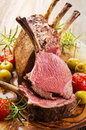 Grilled back of venison as closeup on a wooden board Royalty Free Stock Images