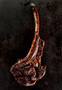 Grilled or barbecued tomahawk steak Royalty Free Stock Photo