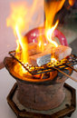 Grilled barracuda in vietnam fish a restaurant nha trang a clay pot gridle is a popular utility to grill fresh fish and meats Stock Photo