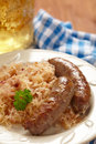 Grilled bavarian sausages with sauerkraut see my other works in portfolio Royalty Free Stock Photos