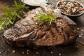 Grilled bbq t bone steak with fresh rosemary Royalty Free Stock Photography