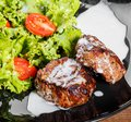 Grilled beaf steak meat with fresh vegetable salad and tomatoes Royalty Free Stock Photo
