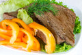 Grilled beef on lettuce leaves with vegetables Royalty Free Stock Photos