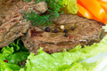 Grilled beef on lettuce leaves with vegetables Stock Image
