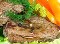 Grilled beef on lettuce leaves with vegetables Royalty Free Stock Photo