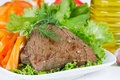 Grilled beef on lettuce leaves with vegetables Stock Photography