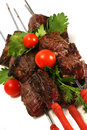 Grilled beef meat on skewer Stock Images
