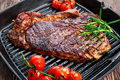 Grilled Beef Sirloin Steak on iron pan with vegetables. Royalty Free Stock Photo