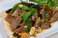 Grilled beef with spicy salad thai food name is Stock Photos