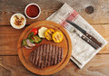 Grilled beef steak, cut into pieces, grilled vegetables - zucchi Royalty Free Stock Photo