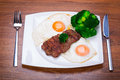 Grilled beef steak with eggs and broccoli Stock Photography