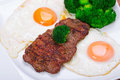 Grilled beef steak with eggs and broccoli Royalty Free Stock Photo