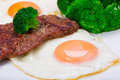Grilled beef steak with eggs and broccoli Royalty Free Stock Photos