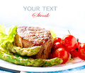 Grilled beef steak meat fried potato asparagus tomatoes Stock Photography