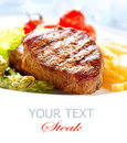 Grilled beef steak meat fried potato asparagus tomatoes Stock Photo