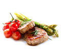 Grilled beef steak meat over white Royalty Free Stock Images