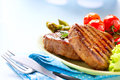 Grilled beef steak meat with vegetables Stock Image