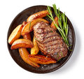 Grilled beef steak and potatoes Royalty Free Stock Photo