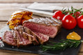 Grilled beef steak rare sliced with vegetables Stock Photography