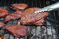 Grilled beef steaks on BBQ grill Royalty Free Stock Photo