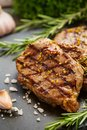 Grilled beef steaks with spices Royalty Free Stock Photo