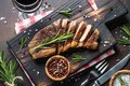 Grilled beef striploin steak with red wine glass. Royalty Free Stock Photo