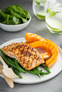 Grilled blackened salmon fillet with grilled squash butternut Stock Image
