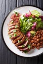 Grilled Carne Asada steak with salad and beans close-up. Vertica Royalty Free Stock Photo