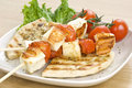 Grilled cheese(haloumi) and tomato souvlaki Stock Image