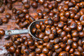 Grilled chestnuts in weave basket display for sale in a market s Royalty Free Stock Photo