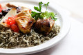 Grilled chicken atop a bed of dill rice Royalty Free Stock Photo