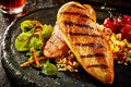 Grilled chicken breast with couscous Royalty Free Stock Photo