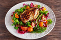 Grilled Chicken Breast fillet with fresh tomatoes vegetables salad. concept healthy food. Royalty Free Stock Photo